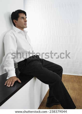 Dressed up Man Sitting on Bench