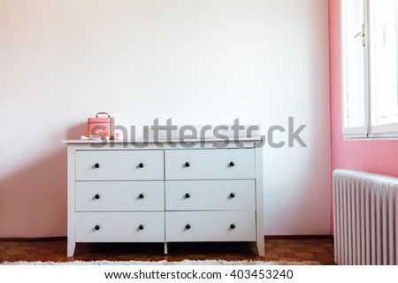 Dresser for dressing babies. Bedroom for baby girl.
