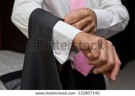 Dressing of the Groom - stock photo