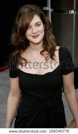 """Drew Barrymore attends the World Premiere of """"Curious George"""" held at the ArcLight Cinemas in Hollywood, California on January 28, 2006. - stock photo"""