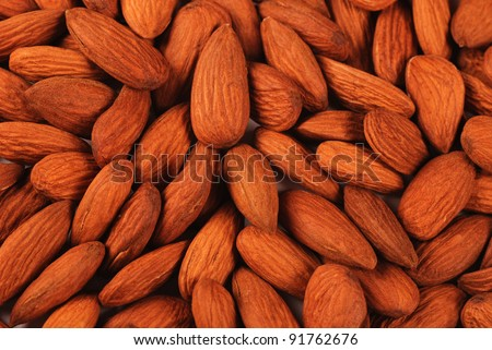 Dried almond nuts background close-up - stock photo