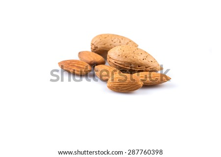 Dried almonds isolated on a white background - stock photo