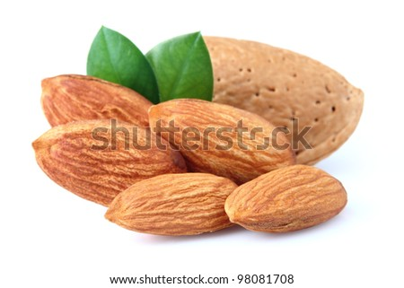 Dried almonds with leaves - stock photo