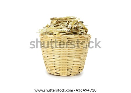 Dried Anchovies Fish in wood basket with isolated on white background