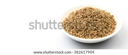 Dried anise seed or aniseed in white bowl over white background - stock photo