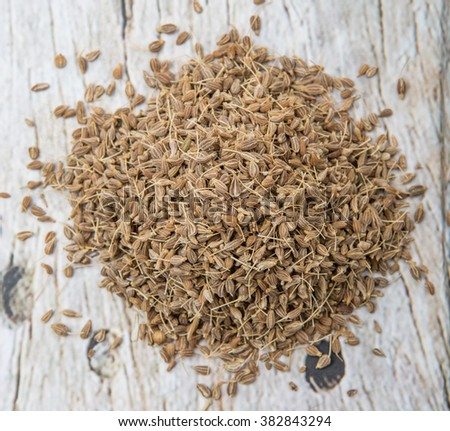 Dried anise seed or aniseed over wooden background
