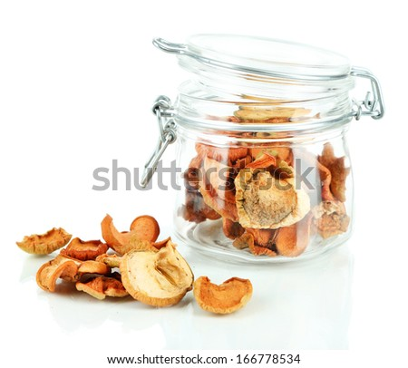 Dried apples in glass jar, isolated on white - stock photo