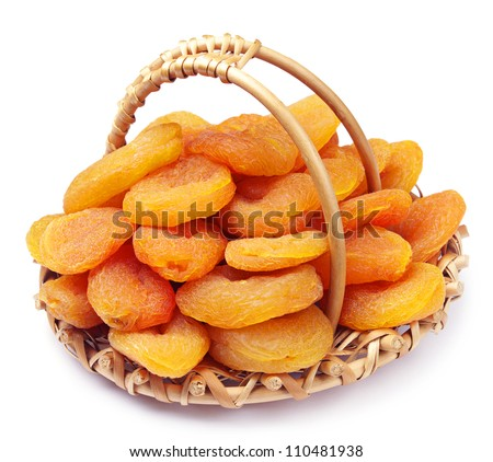 Dried apricots in a wicker basket on white - stock photo