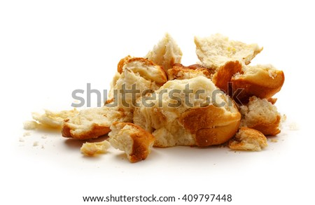 Dried bread crumbs on the white background - stock photo