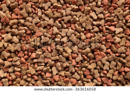 Dried cat food, shaped kitty kibble as an abstract background texture - stock photo
