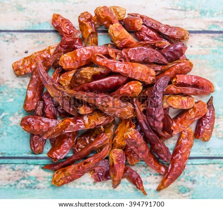 Dried cayenne pepper over wooden background - stock photo