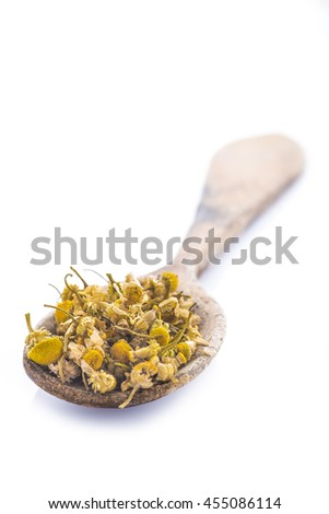 Dried chamomile or camomile flowers to make medicinal infusions isolated on a white background - stock photo