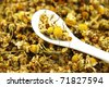 Dried chamomile with white spoon - stock photo