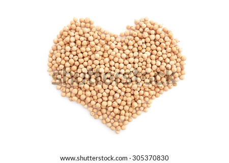 Dried chick peas in a heart shape, isolated on a white background