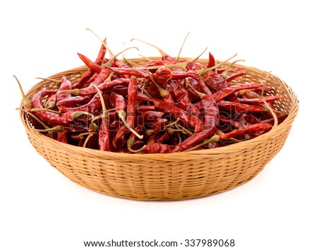 dried chili in bamboo basket - stock photo