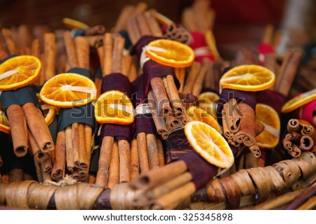 Dried citrus, cinnamon and berries on a thread on the Hungarian Fair. Christmas souvenir flavor from Hungary. Winter fragrant set of natural ingredients. - stock photo