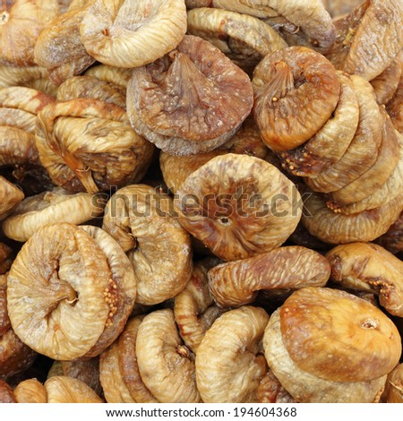 dried common fig fruits as background - stock photo
