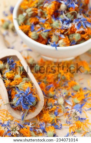 Dried cornflower and marigold tea - stock photo