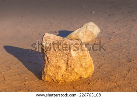 Dried Cracked ground and rocks - exhausted terrain without water - stock photo