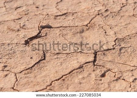 Dried Cracked ground texture - exhausted terrain without water - stock photo