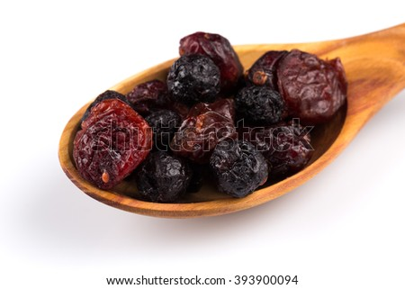 Dried cranberries, cherries and blueberries on white background