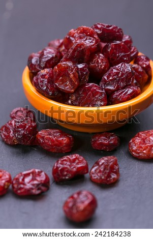 dried cranberries in a bowl ,ruit full of vitamin c. - stock photo