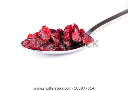 Dried cranberries on a spoon - stock photo