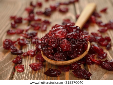 Dried cranberries on brown background - stock photo