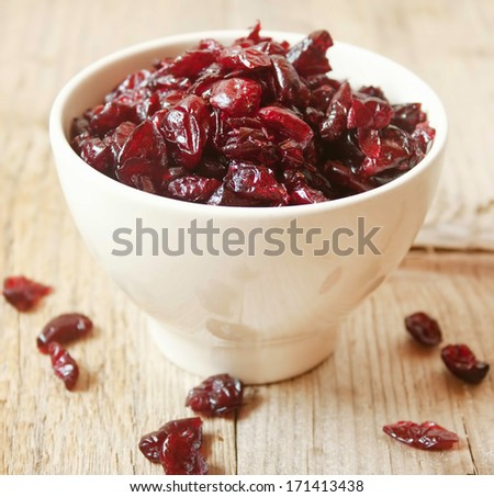 Dried cranberries placed in a bowl,sweet dehydrated fruits - stock photo