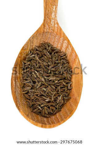 dried cumin in a wooden spoon - stock photo