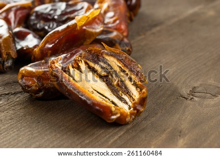 Dried date palm fruits or kurma, ramadan food on wooden background