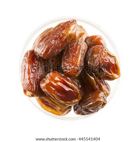 Dried dates in bowl, isolated on white and viewed from above.