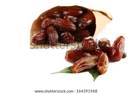 Dried dates in paper cone isolated on white