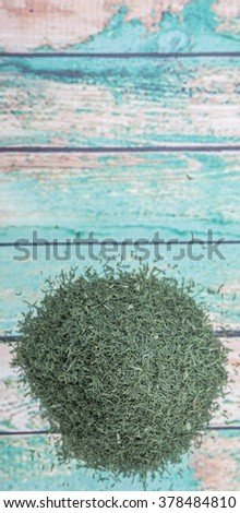Dried dill herbs over rustic wooden background