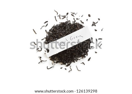 Dried Earl grey tea leaves with name tag over white background - stock photo