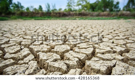 Dried earth because of rain dose not fall and the land lacked of water for agriculture,dried land in Thailand - stock photo