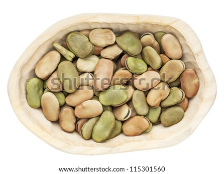 dried fava (broad) bean in a rustic wood bowl isolated on white - stock photo