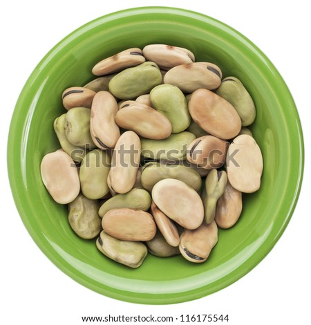 dried fava (broad) bean in a small ceramic bowl isolated on white - stock photo