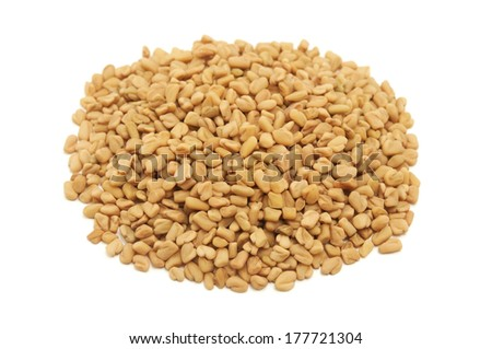 Dried fenugreek seeds on a white background - stock photo