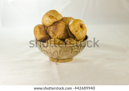 Dried figs delicious in copper bowl - stock photo