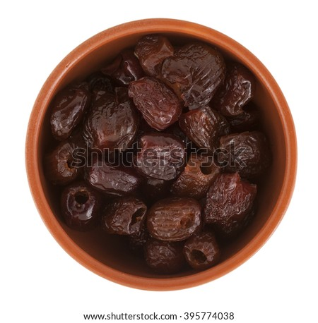 Dried figs in a brown mask, isolated on white background