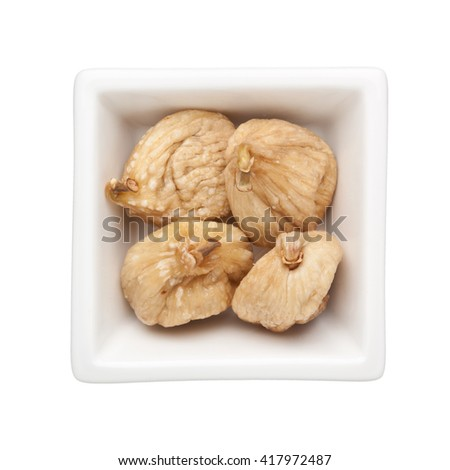 Dried figs in a square bowl isolated on white background