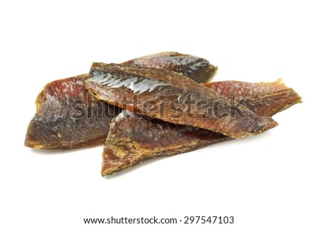 dried fish fillets on a white background
