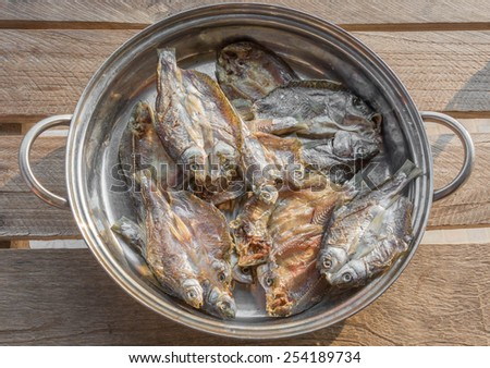 dried fish in stainless bowl  - stock photo
