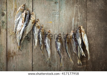 Dried fish on old boards