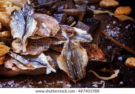 Dried fish to beer, selective focus