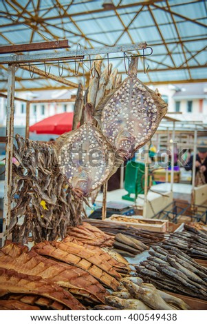 Dried fishes hanged with the ropes in of fish market