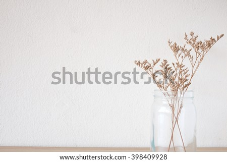 Dried Flowers in the Glass Jar for decoration with Empty Wall in Minimal Style - stock photo