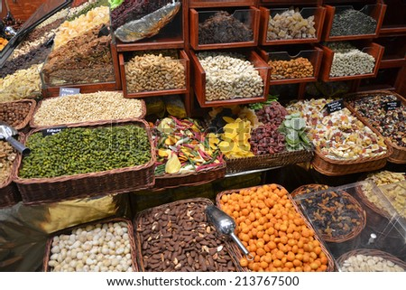 dried fruit and nuts for sale at a market stall