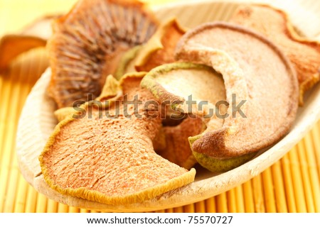 dried fruit in a large wooden spoon
